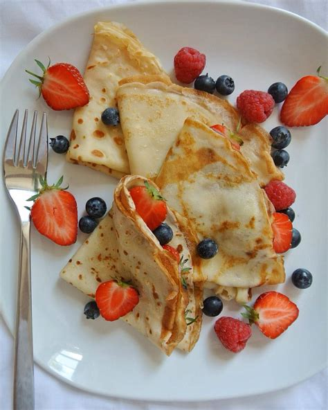 french style crepes  berries  sugar