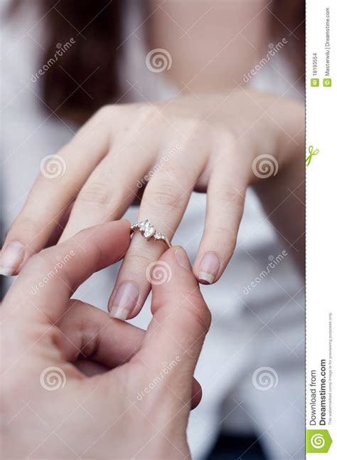 wedding ring and engagement finger engagement ring into a finger stock images image 18193554