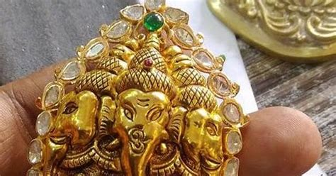 ganesh embossed tiger claw pendant jewellery designs
