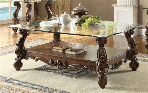 The loire coffee table is shown in cherry wood with a royal blue finish and top in honeycomb. Acme 82100 Versailles cherry oak finish wood carved accents glass top coffee table | Coffee ...