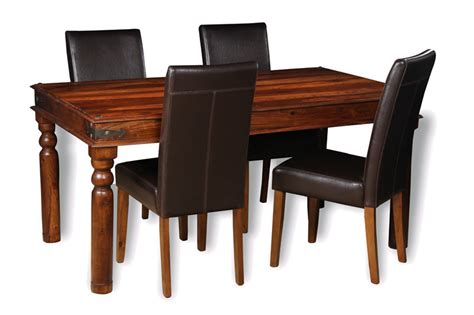 indian jali dining room table and leather chairs