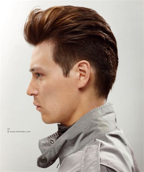 Short mens haircut with a quiff and a clipped nape   Side view
