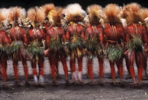 huli men dance  sing sing papua  guinea art wolfe