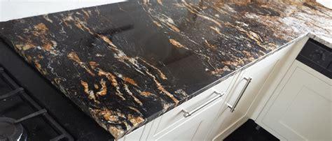 black vanity bathroom cosmic black granite tiles worktops flooring wall