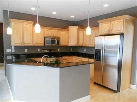 black granite countertop maple cabinets kitchen ideas