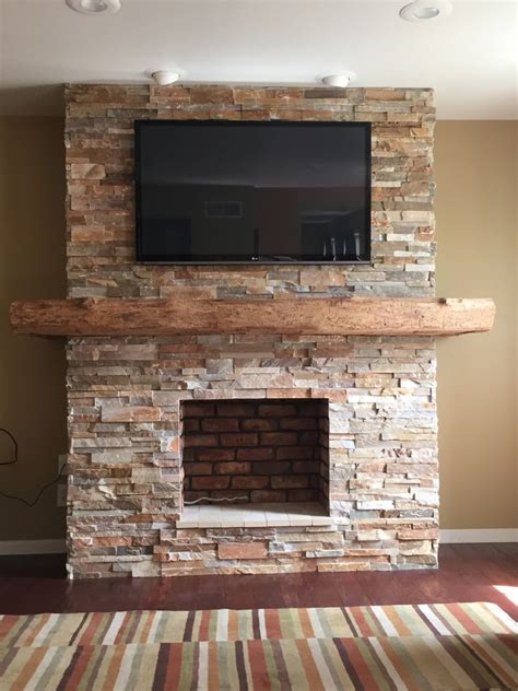 stone fireplace  wrap  barn beam mantel