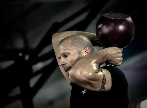 kettlebell training workout fitness trainer strength gym exercise muscle crossfit testosterone older exercising levels strong instructor healthy athlete bodybuilding halo