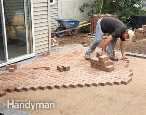 how to cover a concrete patio with pavers the family