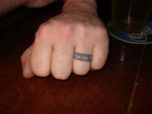 Wedding ring tattoos designs ideas and meaning tattoos for Tattoo wedding rings