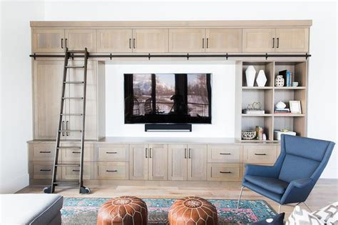 Beige Living Room Built In Bookcase With Ladder On Rails Nelson Bauer Funeral Home Nerdy Decor Column Decorations Arts And Crafts Diy Ideas On A Budget Up Vaala Work From Start Today