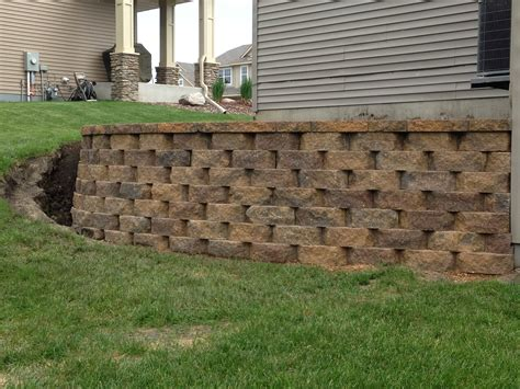 retaining wall on steep slope turn a steep slope into a beautiful retaining wall would love to do down side and around back