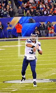 Seattle Seahawks Russell Wilson completes a pass to his ...