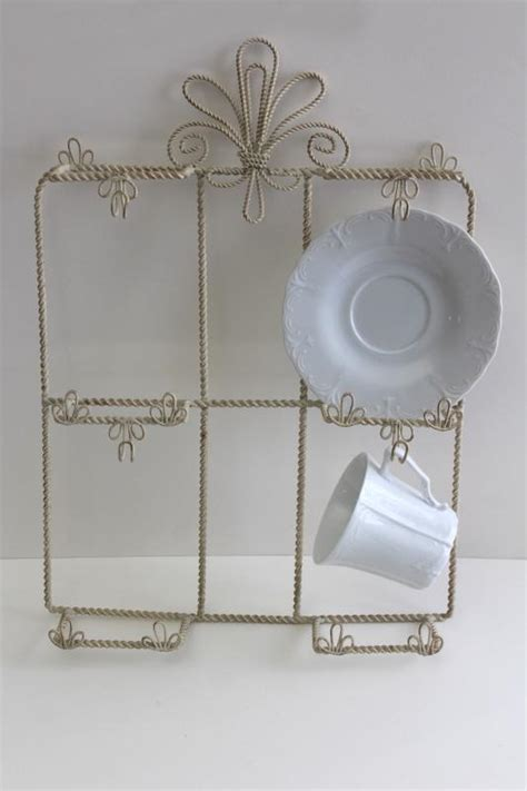 vintage wrought wire wall mount display rack  cups saucers french farmhouse style wirework