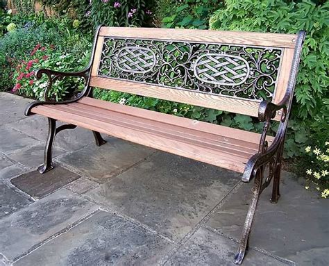 cast iron and oak wood bench w arms scrollw