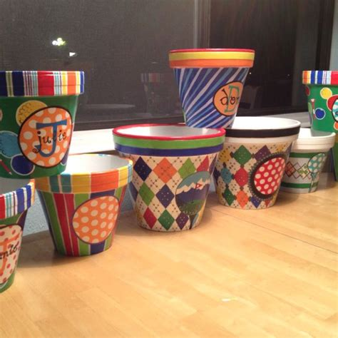 painting terra cotta pots with acrylic paint makes the possibilities for your pots endless wine