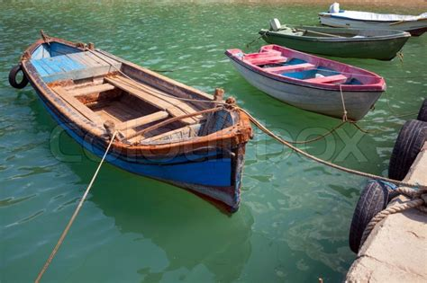 small wooden fishing boats moored stock photo