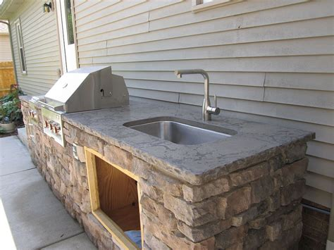 outdoor grill with sink another outdoor kitchen installed today retractable