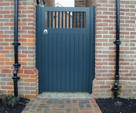 painted solid gate with spindle top section garden gates