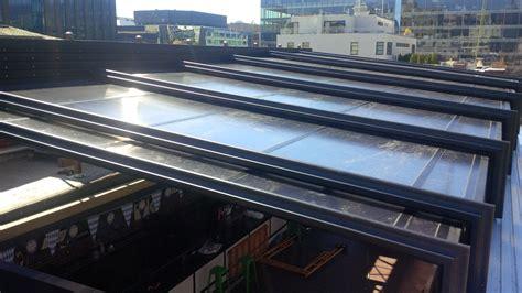 roll  covers retractable skylight enclosure  sauf haus  washington dc sauf haus