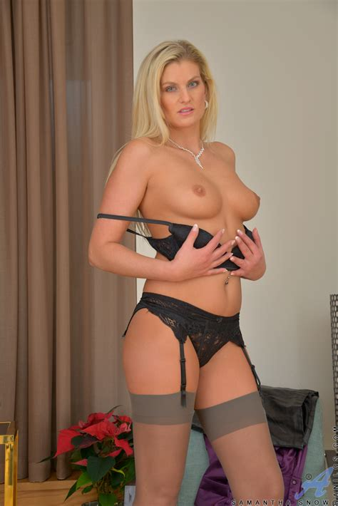 hot blonde milf In Stockings posing To Display Her Firm boobs And naked Pussy
