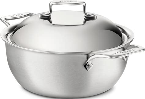 clad  le creuset stainless steel  enameled cast iron
