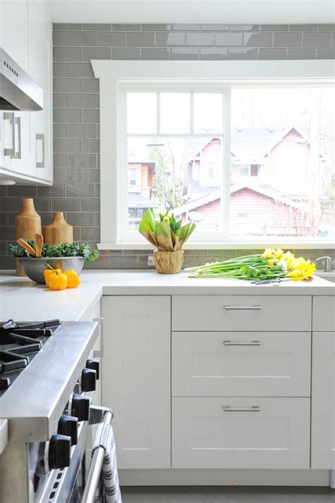 white kitchen  grey backsplash transitional kitchen
