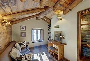 Diseño de interiores rústico uso de madera y piedra