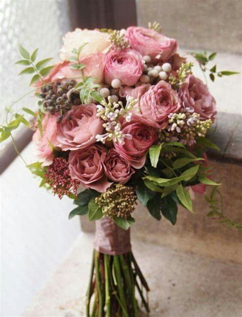 mauve colored wedding bouquet flowers ranunculus