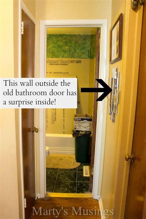 door solutions for tight spaces built in bathroom storage
