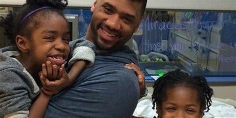 russell wilson     visiting sick kids