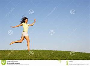 Young Woman Running Through Field Royalty Free Stock ...