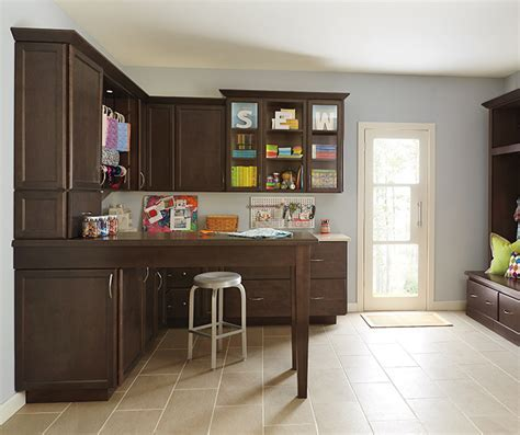 Dark Maple Craft Room Cabinets   Kemper Cabinetry