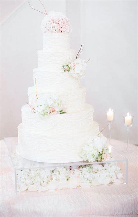 elegant wedding cake table  ivory sequence linen