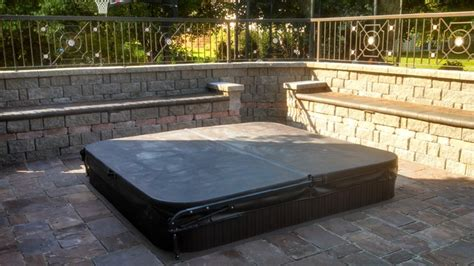 sunken tub paver patio and ornamental fence