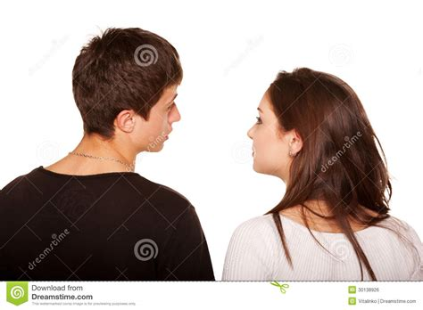 Teens Couple Looking At Something And Talking Rear View