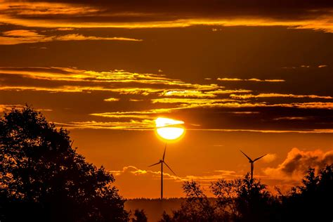 picture sunset wind power plant sun