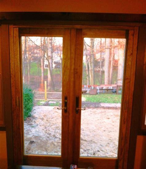 andersen outswing french door with retractable screen