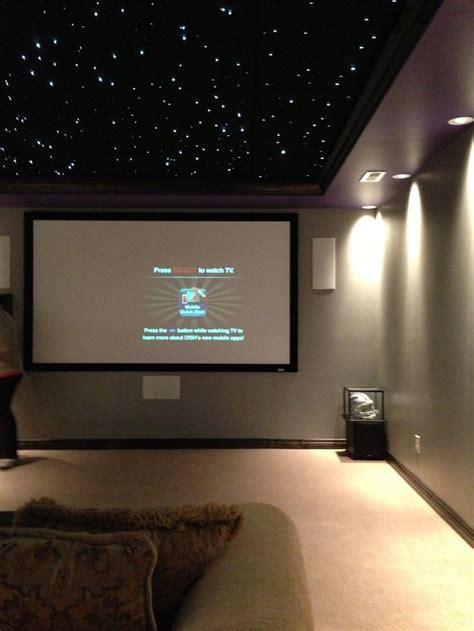 basement media room with black ceiling basement home