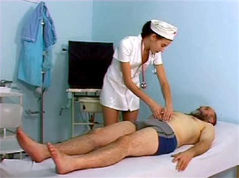 Cute Teenage Nurse Inspecting A Dirty Senior His Sick Bo