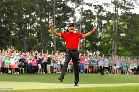 Tiger Woods of the United States celebrates after sinking ...