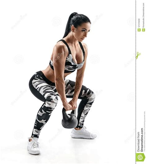 squats kettlebell sporty doing woman fitness preview