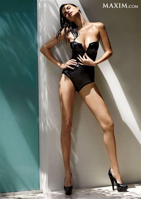 lake bell bikini lake bell in a strapless black bathing suit unzipping