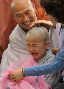 Children become Buddhist monks as tears flow during ...