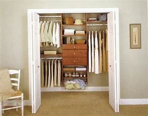 Apartment closet ideas white doors brown wooden cabinets for Apartment closet doors