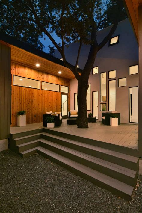bold  modern  shaped courtyard house designed  trees