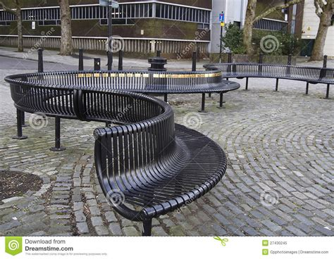 curved metal outdoor seating royalty  stock photo