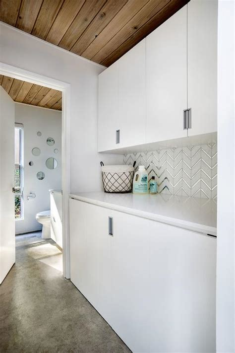 white  silver herringbone laundry backsplash tiles