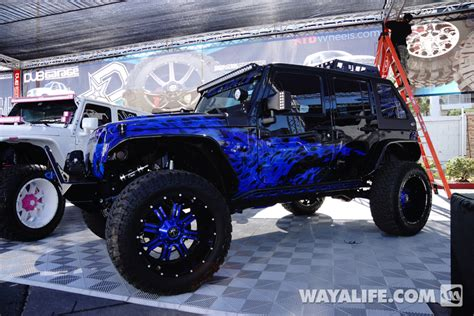 jeep blue and black 2014 sema all out off road purple blue flame black jeep