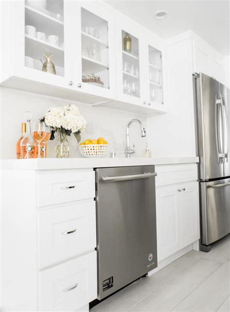 sydne style shares white kitchen decor ideas  silver