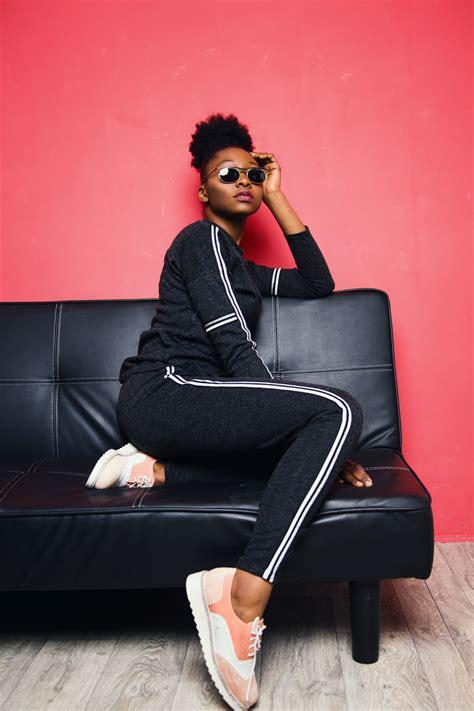 woman sitting  sofa bed wearing sunglasses  stock